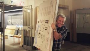 Curator David Bergeron carries coin display panel