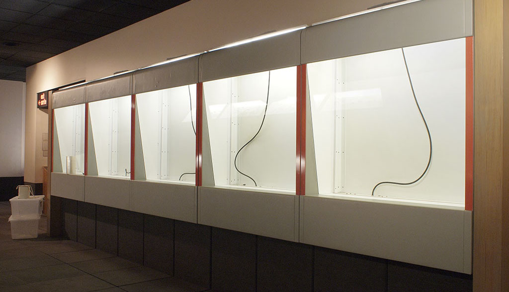 A row of empty museum cases