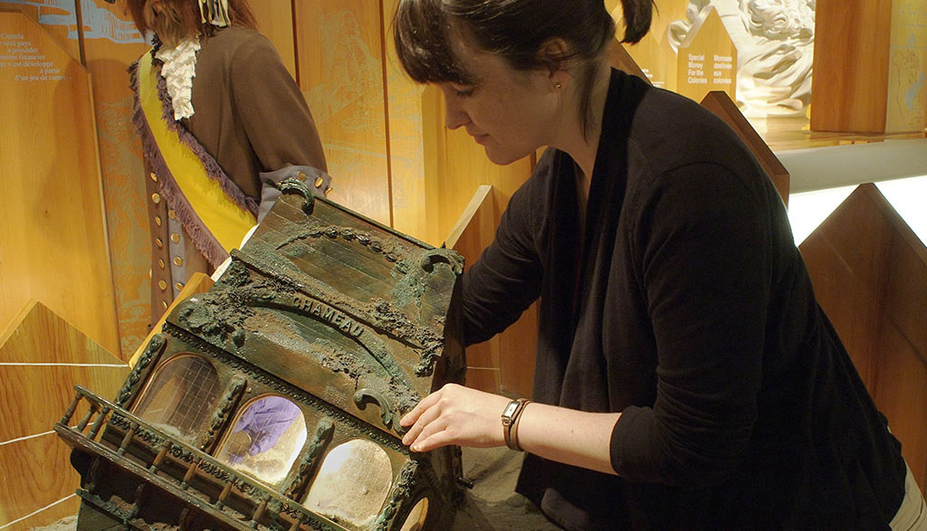 Woman taking coin from a case