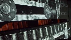 Images of war time industry projected in multimedia show / Images de l'activité industrielle en temps de guerre, tirées du spectacle multimédia