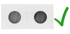 Mylar lined cardboard frames fold over coins, the tight plastic limiting exposure