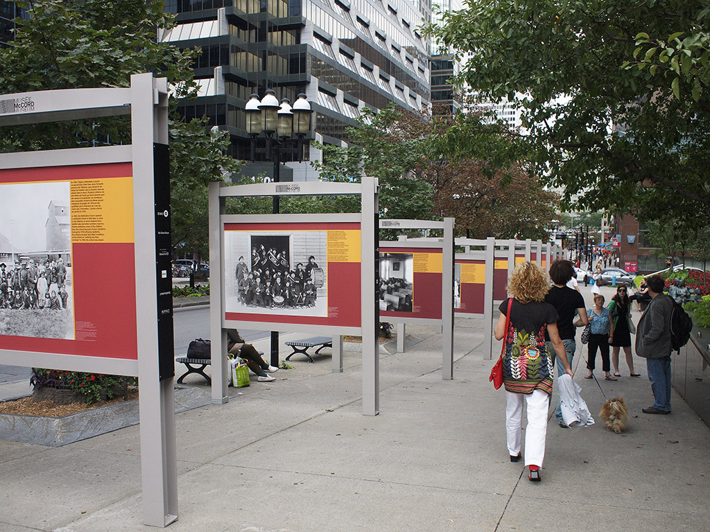 A series of ten outdoor museum panels along a street