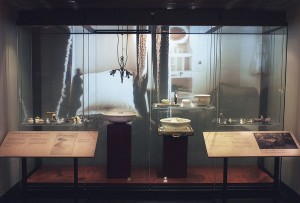An exhibition 'room' featuring artifacts and projected backdrop