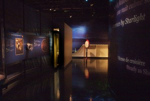 Corridor telling the story of the wreck, looking out to the moonlit St. Lawrence