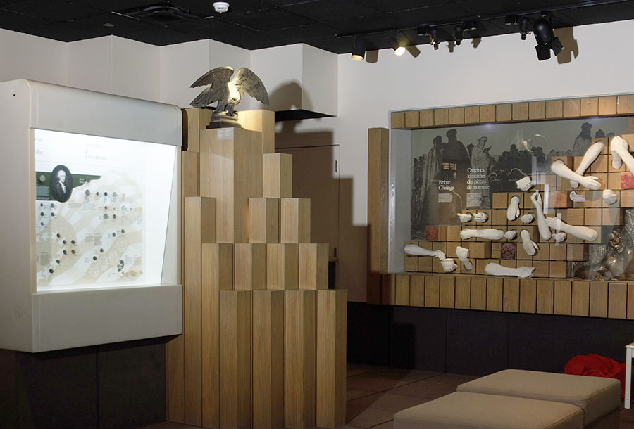 gallery 2 of the old Currency Museum, with a showcase displaying the origins of money
