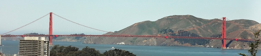 Suspension bridge, ocean and hills