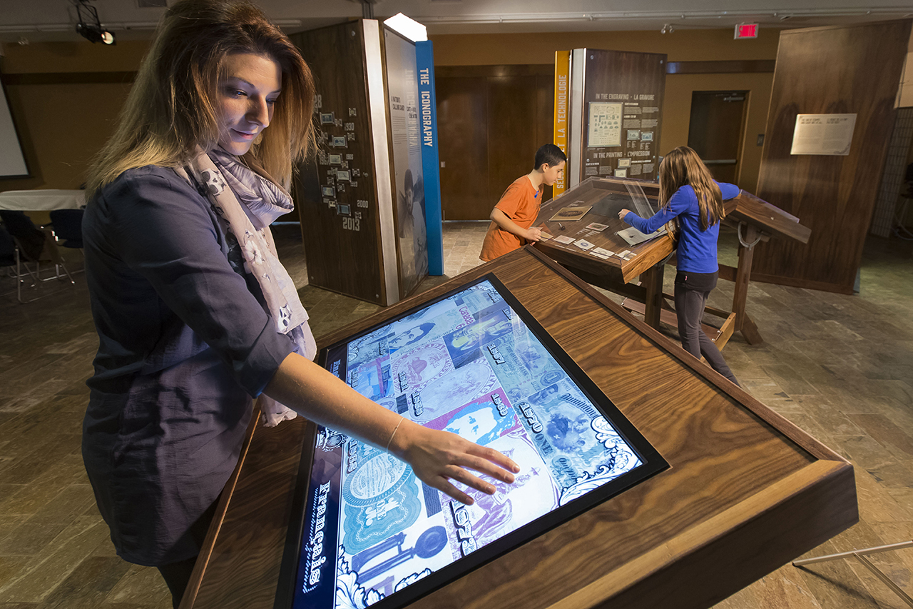 Woman at touch panel