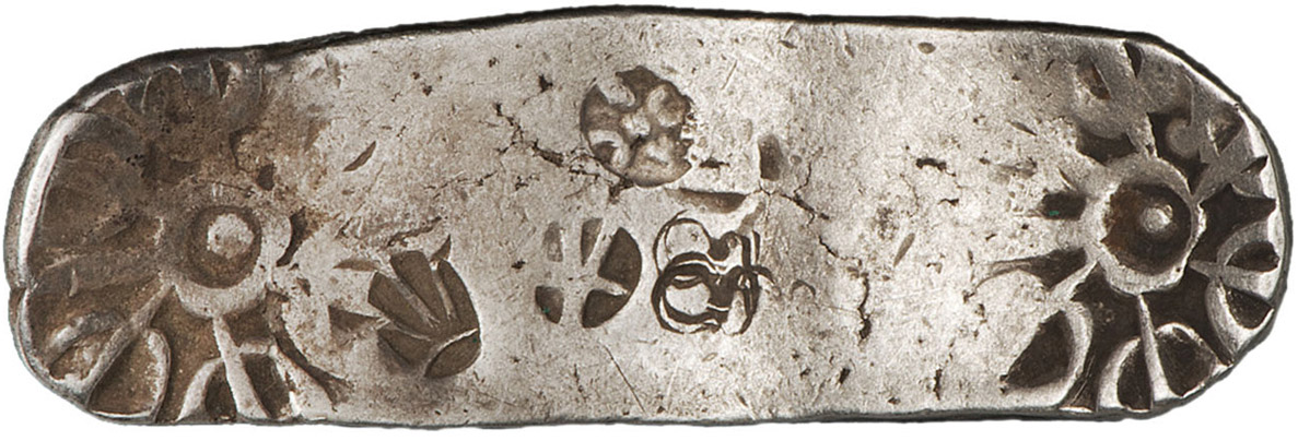 oblong, stamped piece of silver.