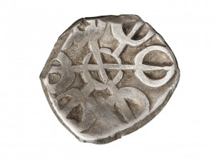 irregularly shaped stamped coin