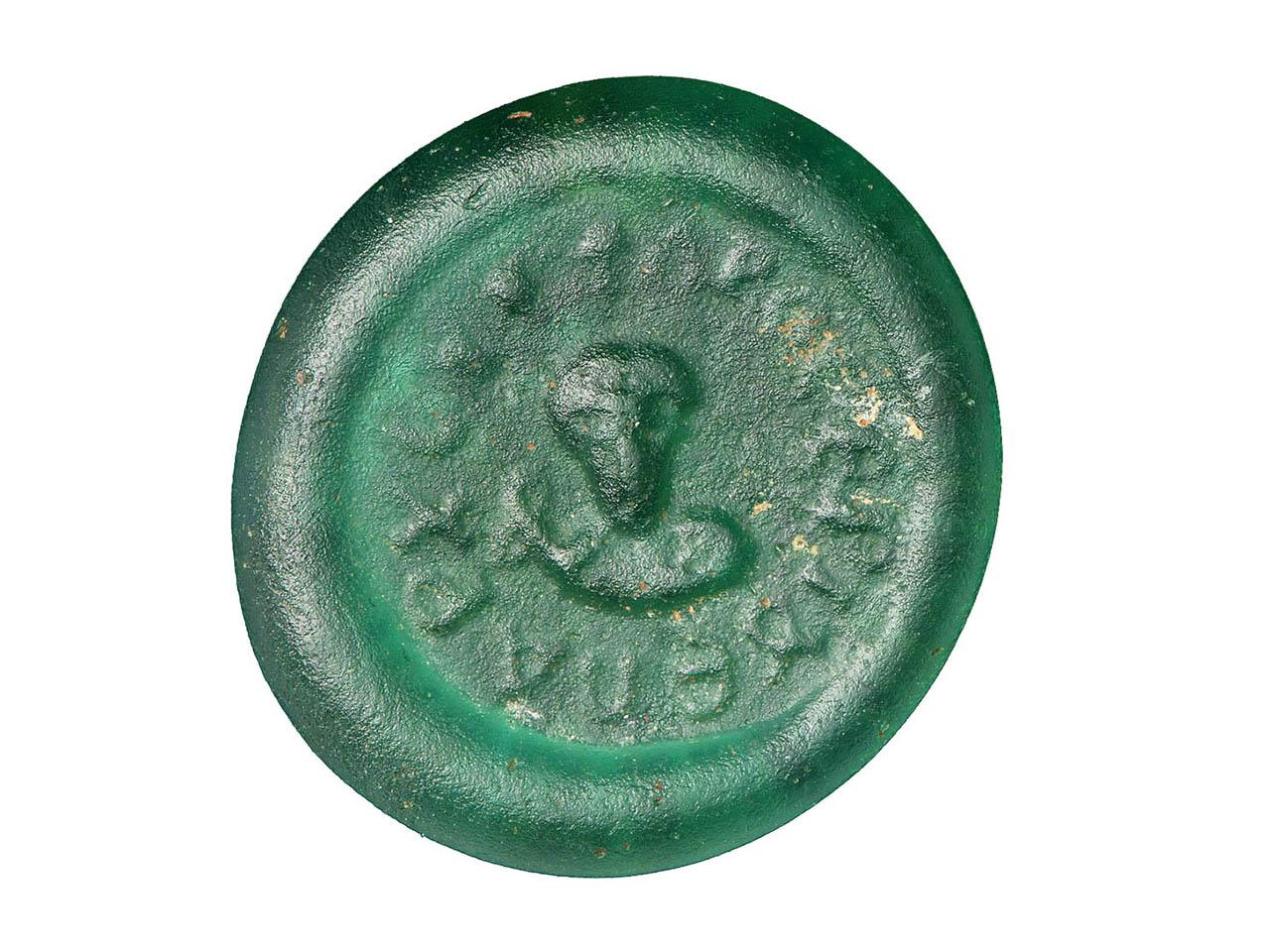 flat, green glass disc