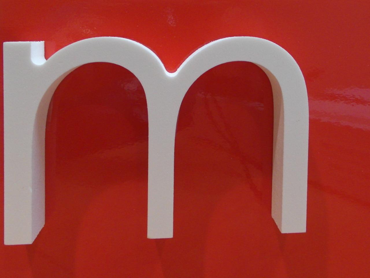 A plastic letter M