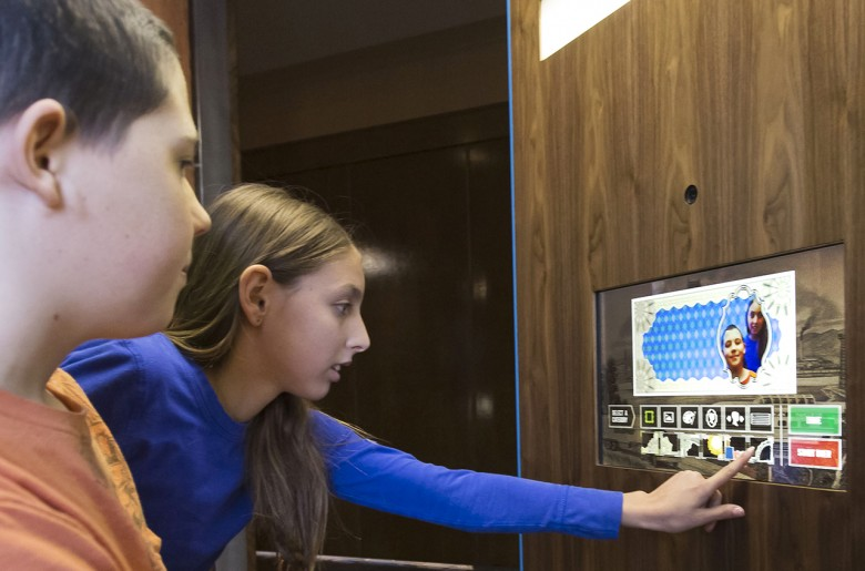 Children operating a touch panel
