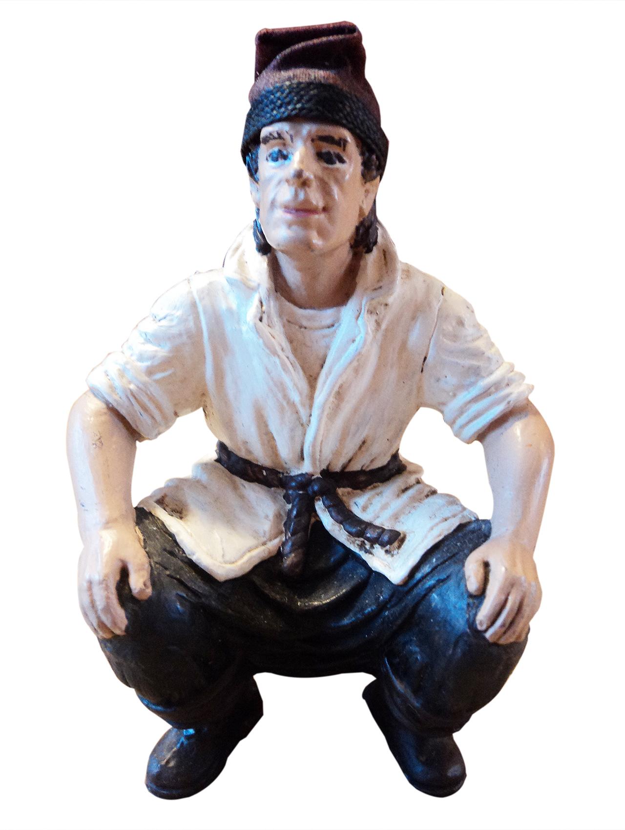 squatting Caganer statue