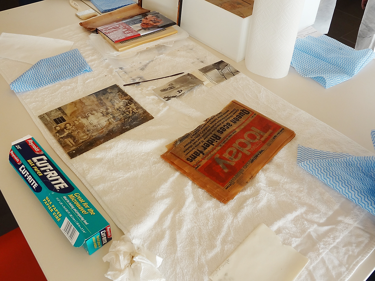 wet paper items laid out on a towel