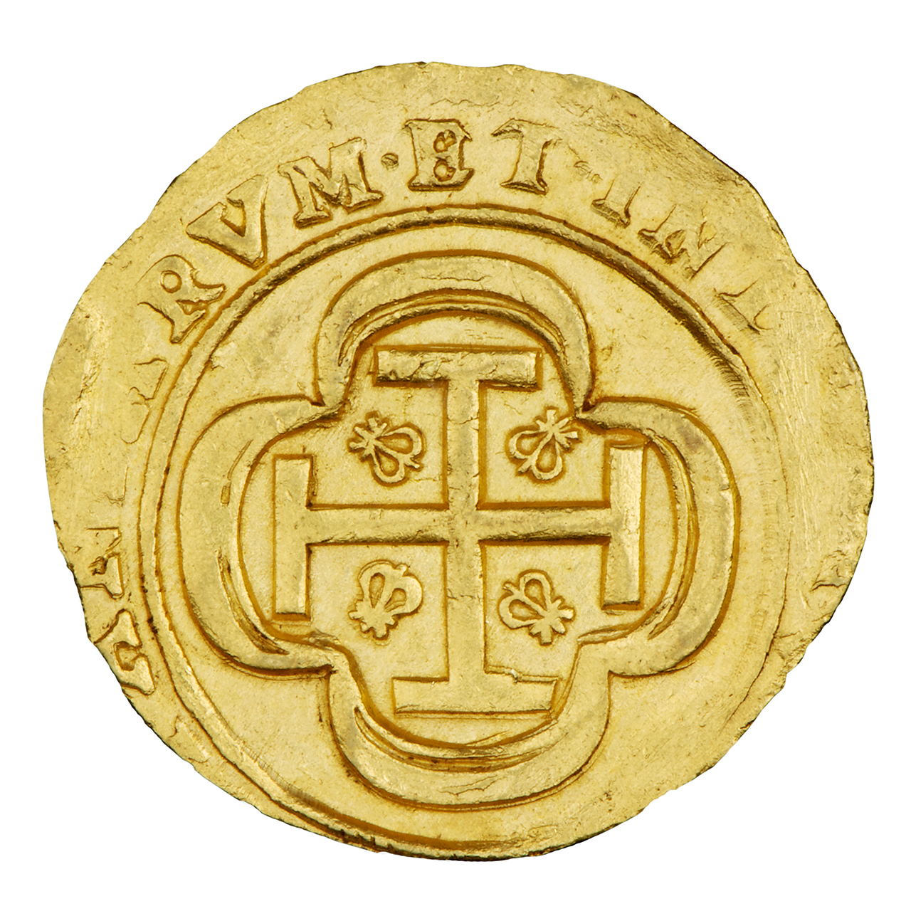 gold coin with a cross embossed on it