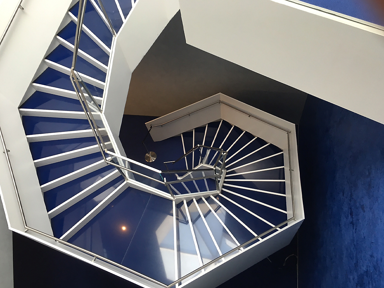 blue and white spiral staircase in the Aga Khan Museum