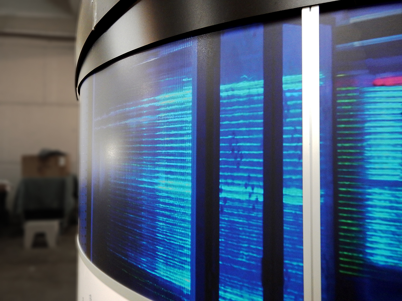 museum panels showing streaks of blue light