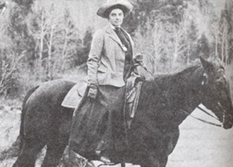 portrait of a woman on a horse