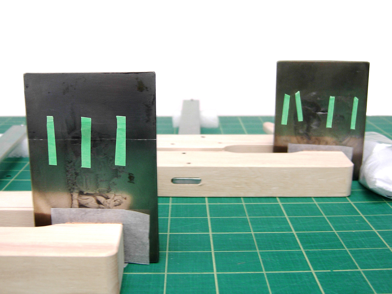 printing plates held in wooden clamps