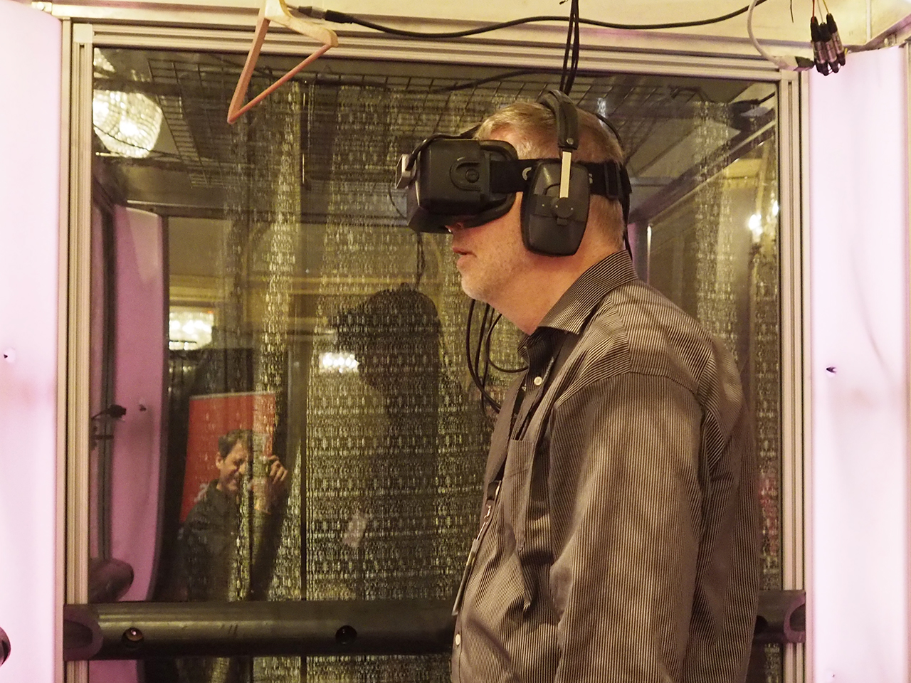 man wearing VR goggles and standing still