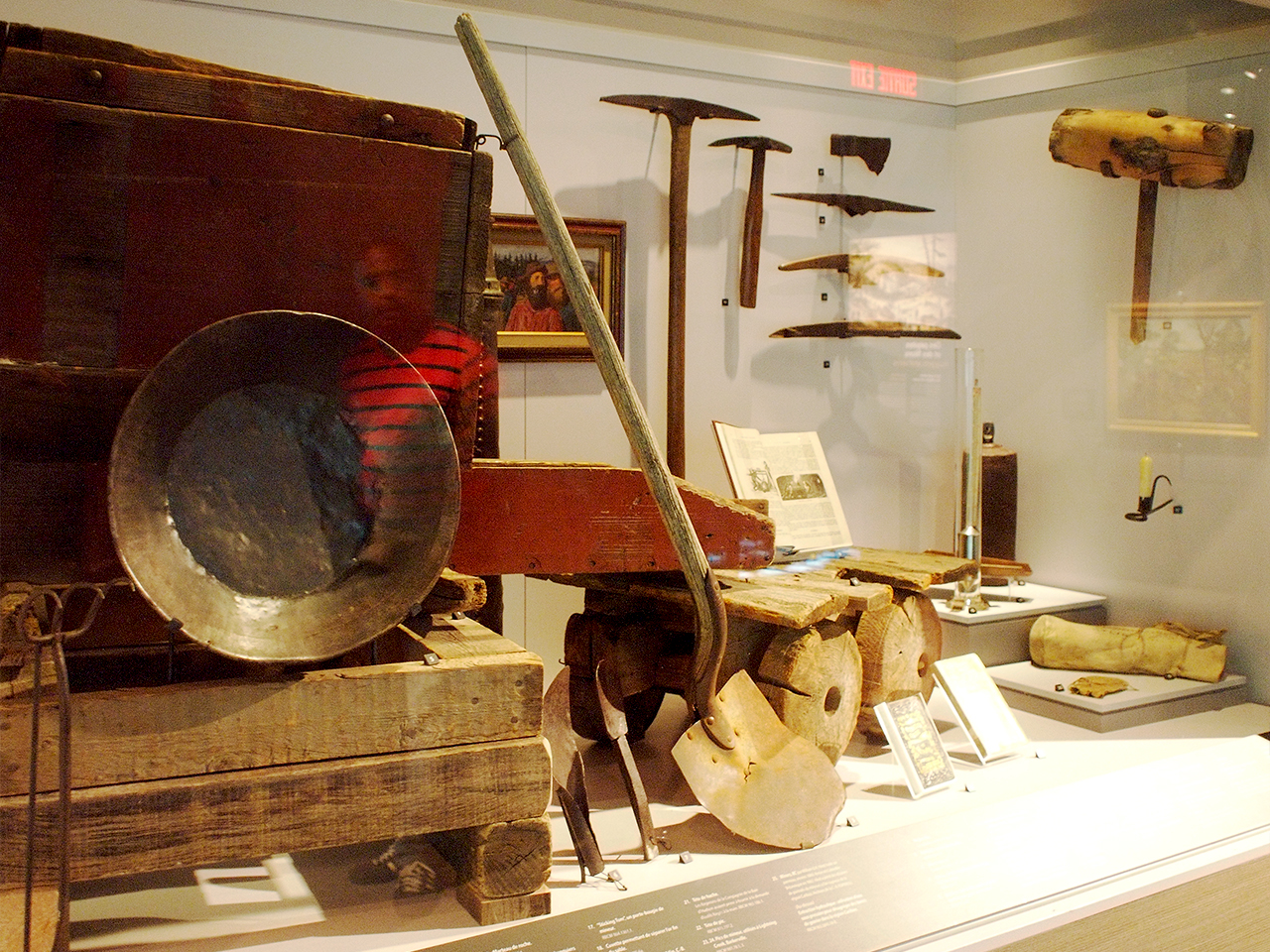 old mining tools in a display case
