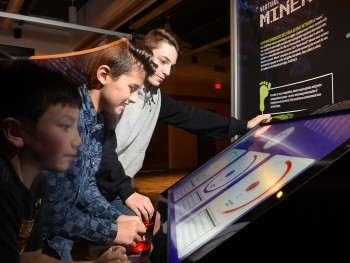 children playing a touch panel game