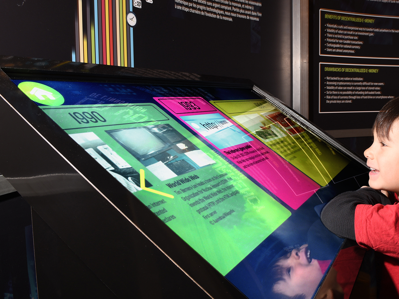 boy at a large touch panel