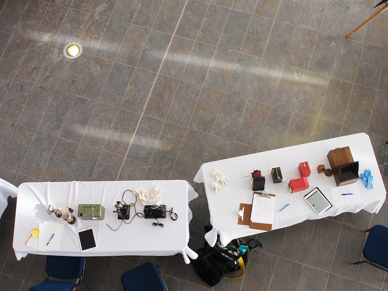 a table with cameras and telephones on it