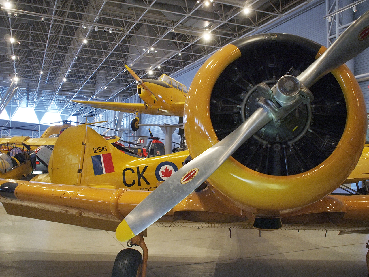 a yellow propeller aircraft