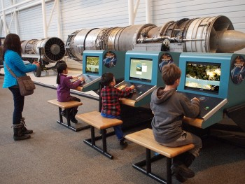 children playing on flight simulators