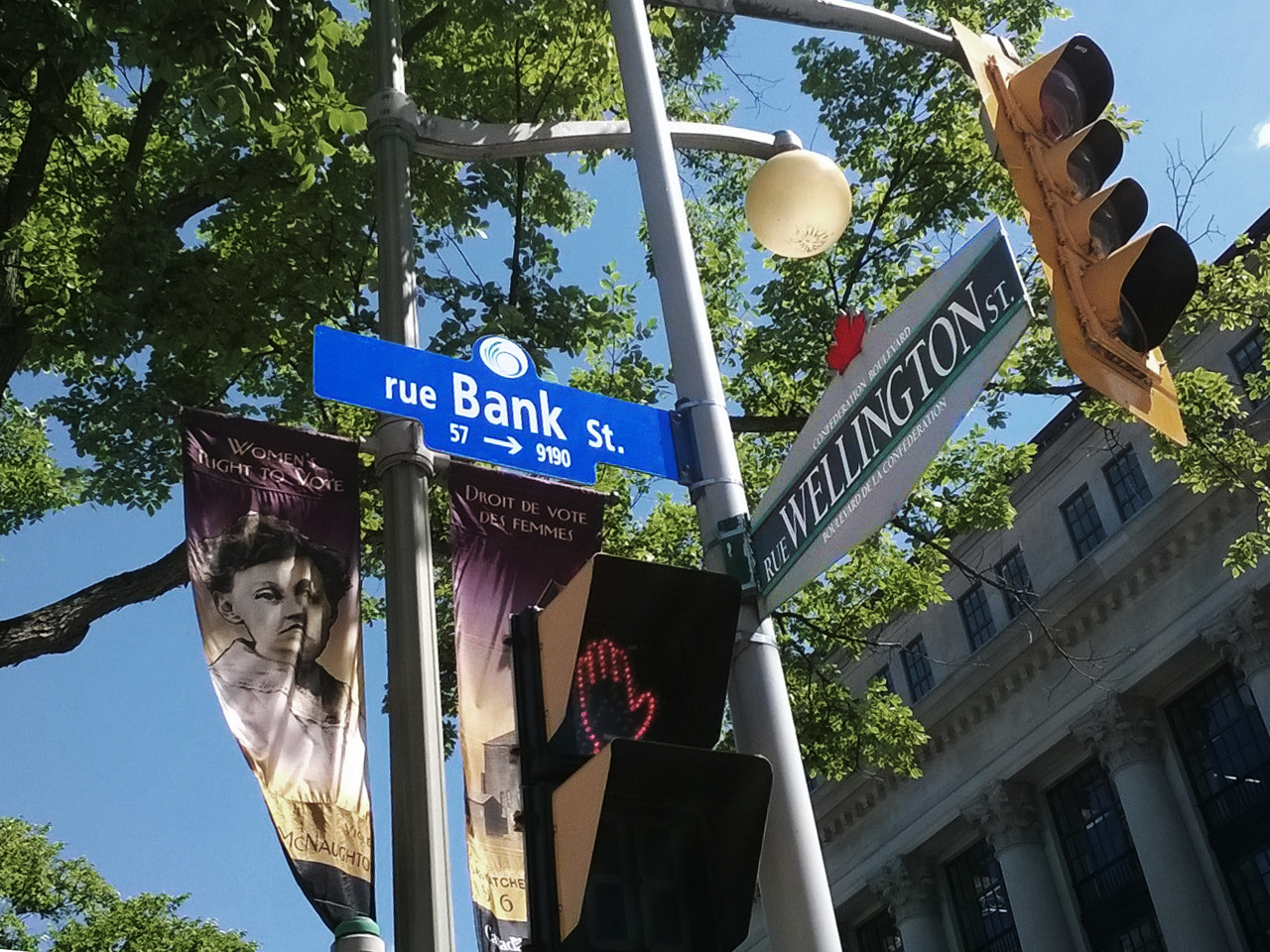 street sign: Bank and Wellington