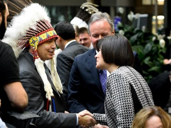Bellegarde and Petitpas Taylor shaking hands