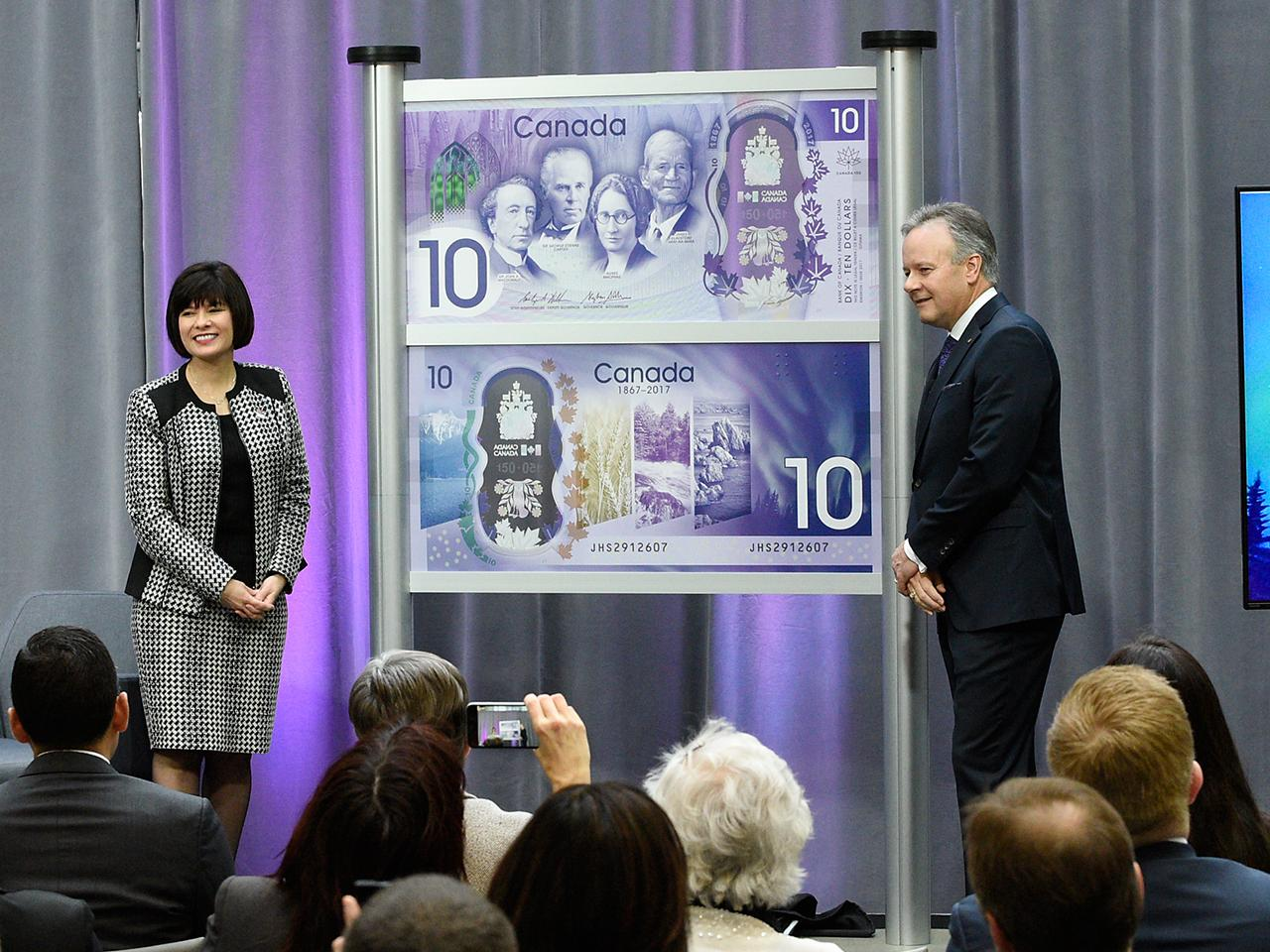 Honourable Petipas Taylor and Governor Poloz reveal note