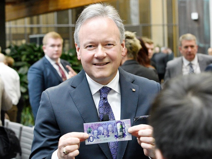 Mr. Poloz holding bank note
