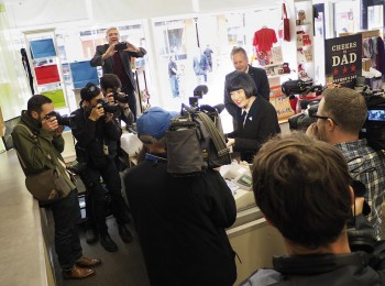 crowd of media in a gift shop