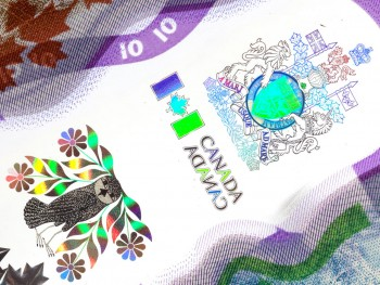 bank note image: owl and coat of arms
