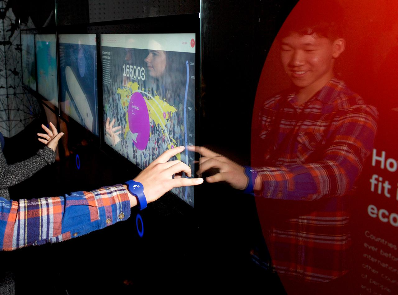 hands manipulating a touch screen