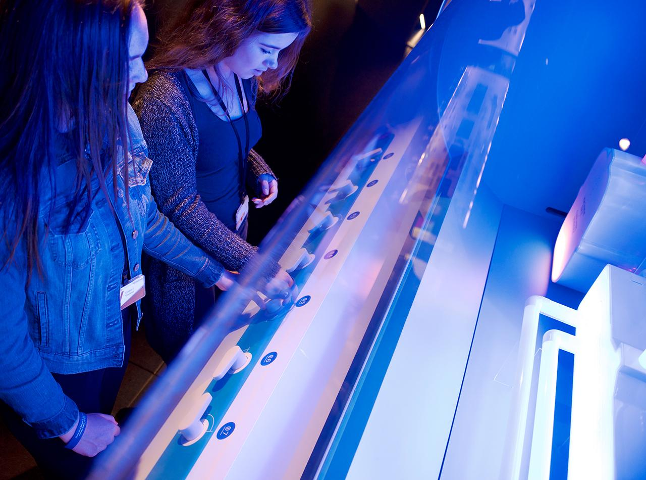 teens at a museum interactive station