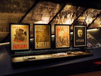 posters of Hitler in museum gallery