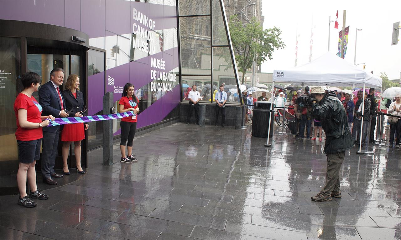 ribbon cutting ceremony in the rain