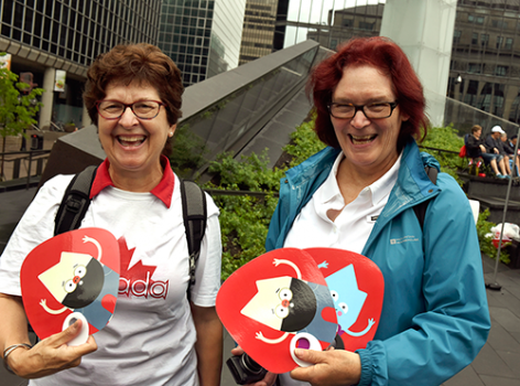 two women holding promotional fans