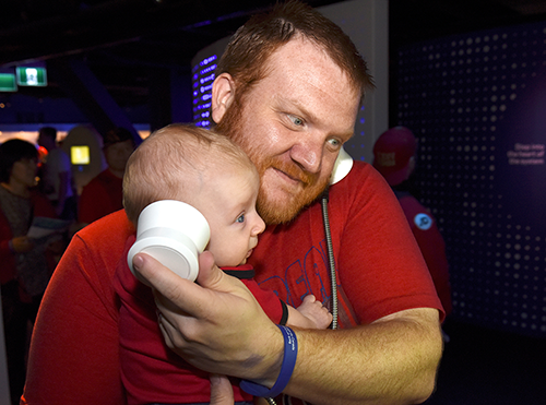 man and baby with headphones
