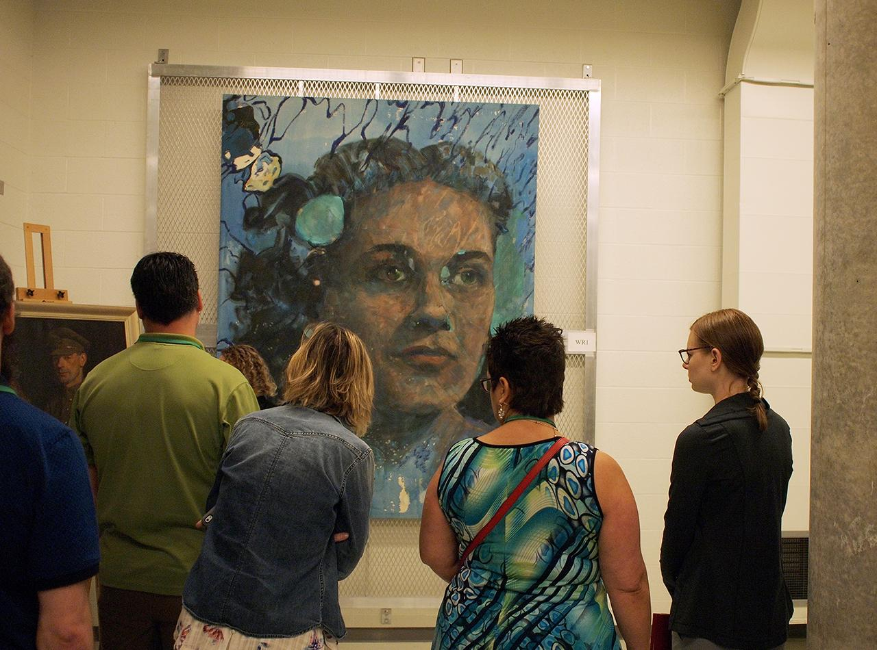 people looking at stored painting