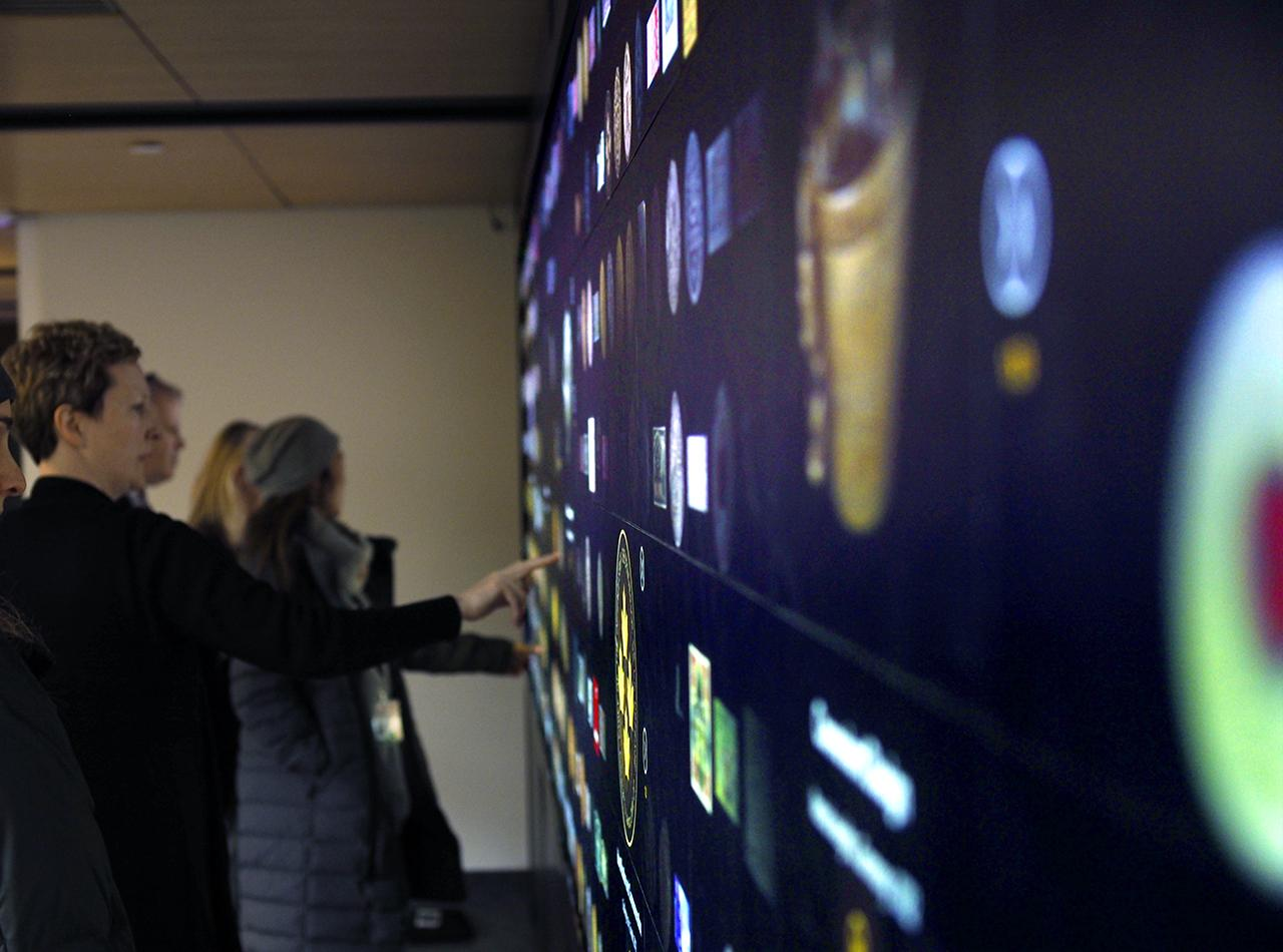 visitors interacting with a digital wall