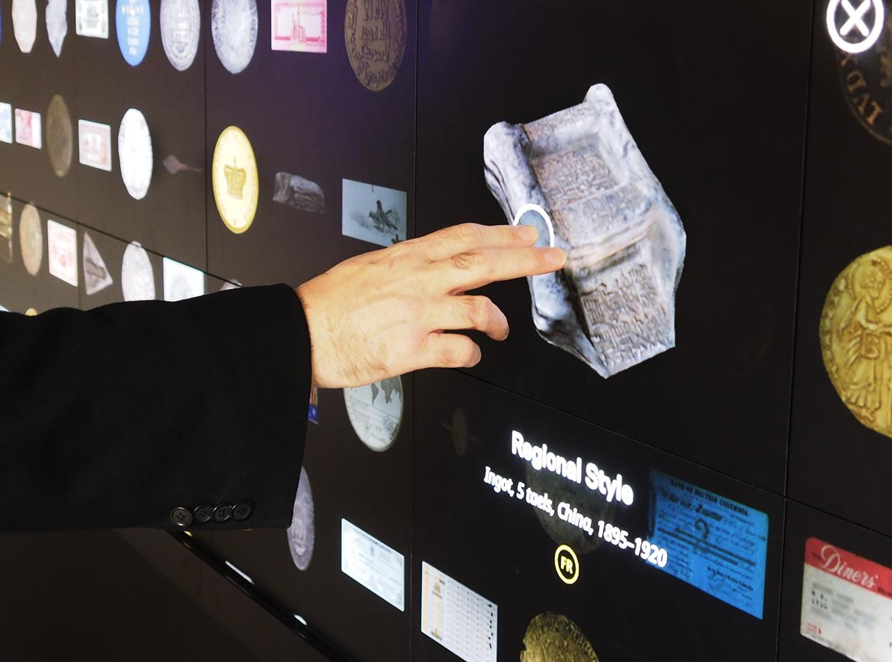 hand touching an artifact image on a screen