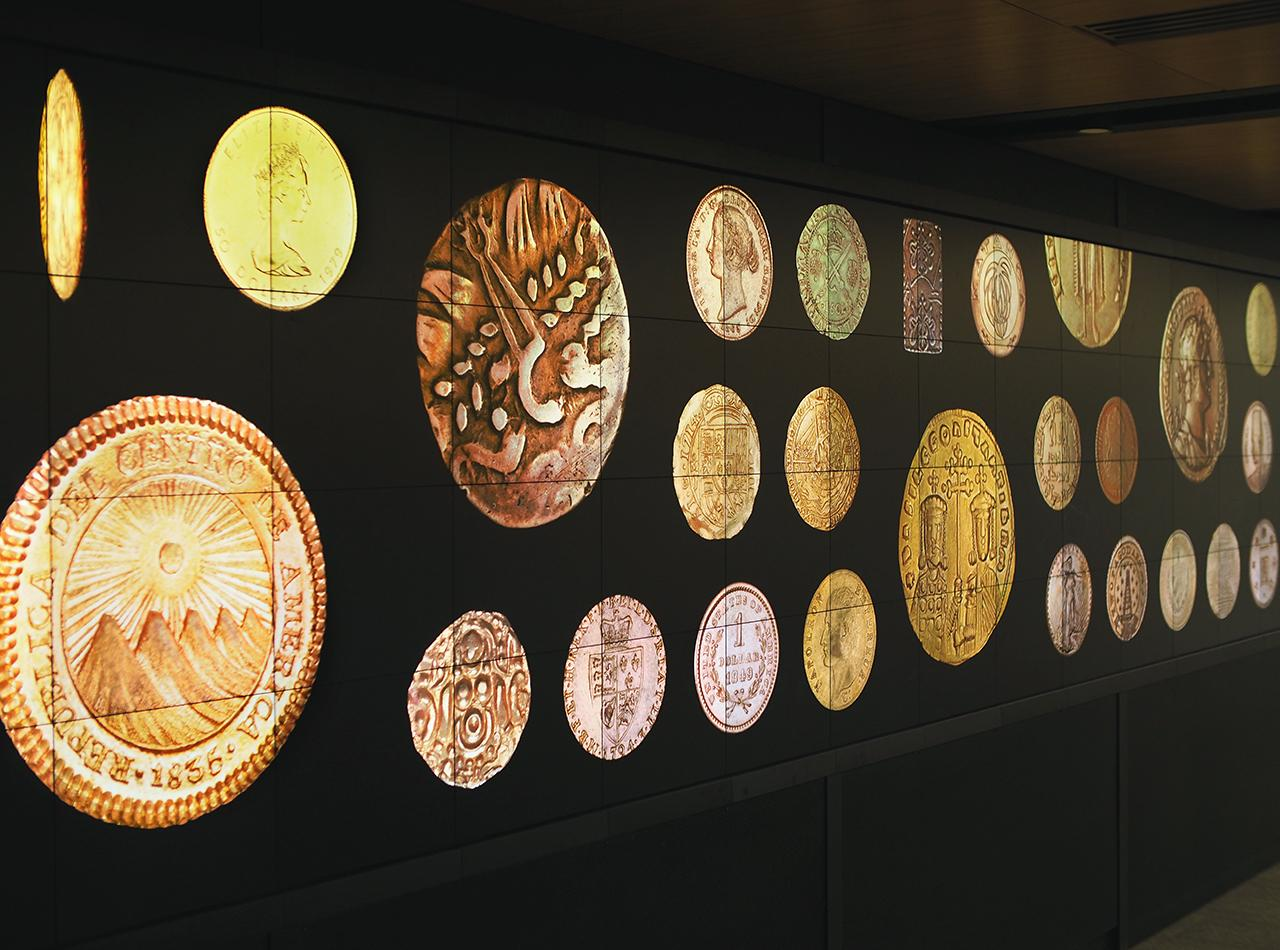gold coins on a big monitor