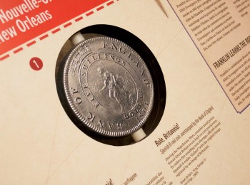large, plastic coin reproduction