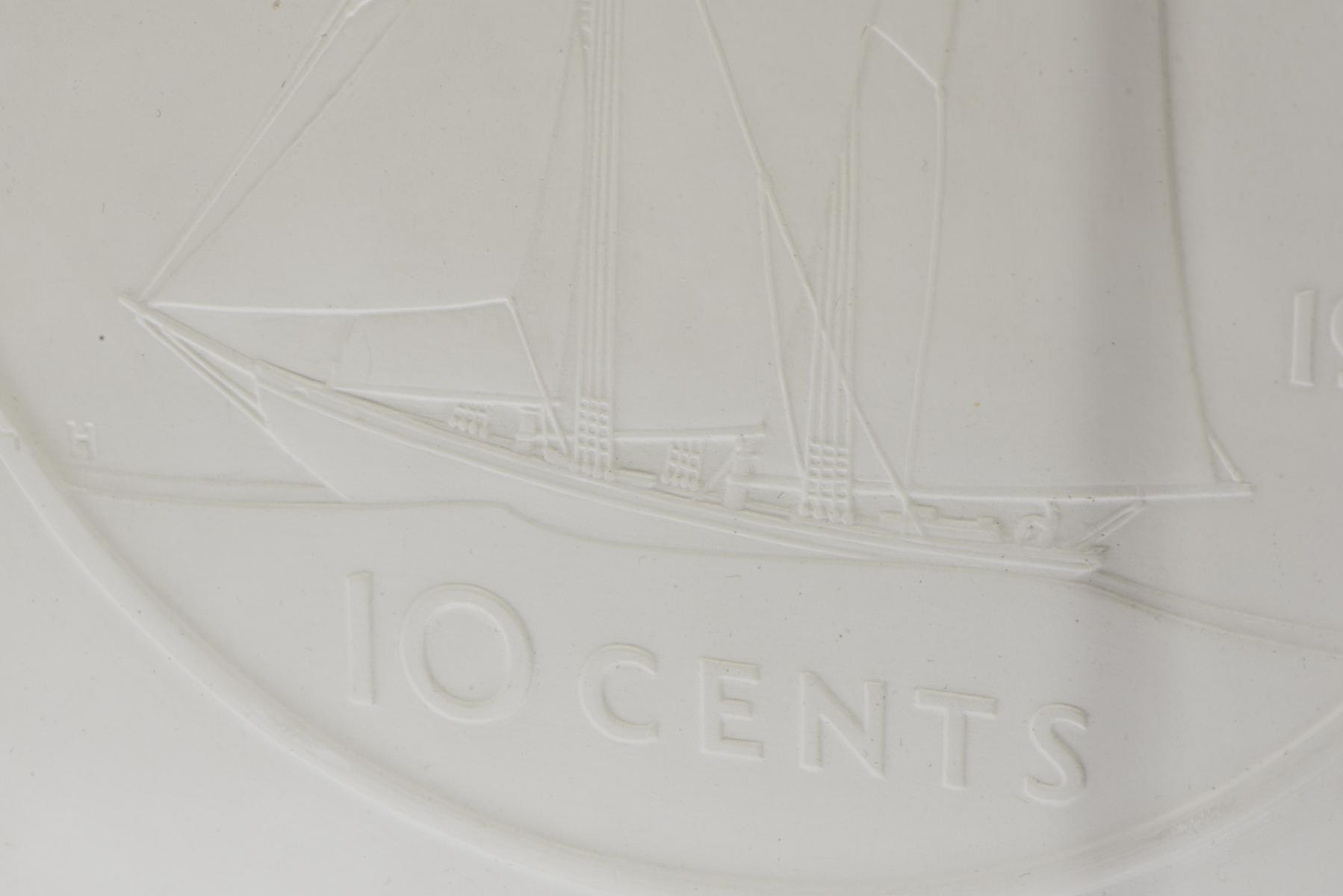 plaster cast of Canadian dime