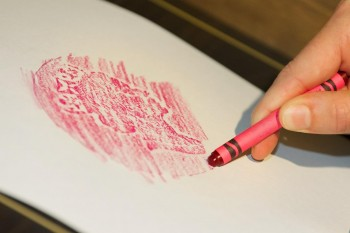 crayon rubbing a giant coin
