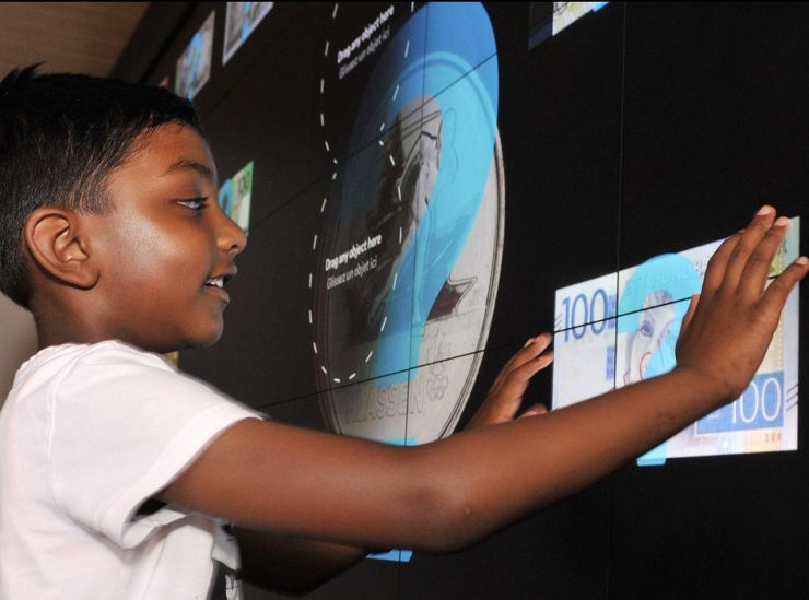 visitor operating digital touch wall